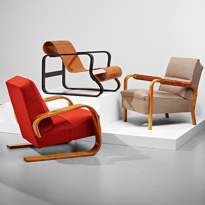 Three design chairs by the iconic Finnish designer Alvar Aalto.