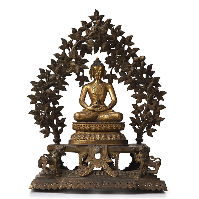 A large Nepalese gilt bronze buddha on a throne with mandorla, 18/19th Century