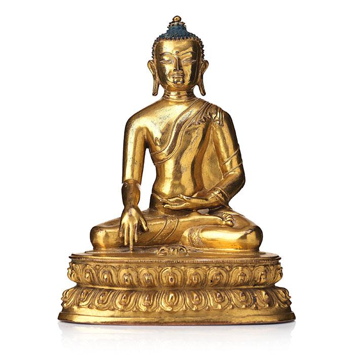 A gilt bronze figure of Akhsobya buddha, Tibet, 15th Century